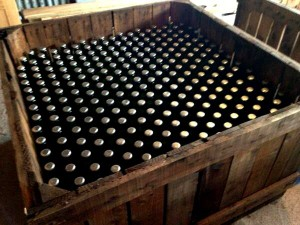 Bottle conditioned cider, crated, to be left for a while.